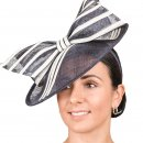Wholesale fascinator developed from sinamay and featuring a disc and bow